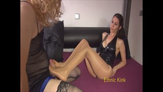 Miss Suzie Gives a Footjob To the Sissy